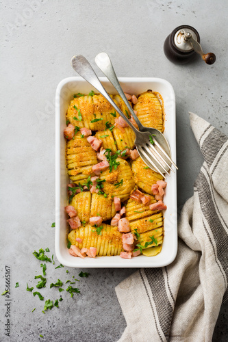 In de dag Assortiment Baked potatoes with ham, herbs and breadcrumbs on gray light background. Scandinavian cuisine. Top view.
