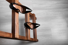 Female Shoes On Wooden Ladder. Concept Of Career Failure