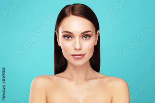 Obraz Yong and perfect. Skin care,Beauty treatment and spa concept. Attractive model with brown hair and  Clean Fresh Skin portrait - fototapety do salonu