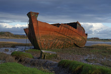 Old Fishing Boat On The Mud