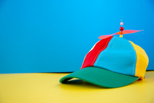 A Colorful Propeller Hat On A Background.