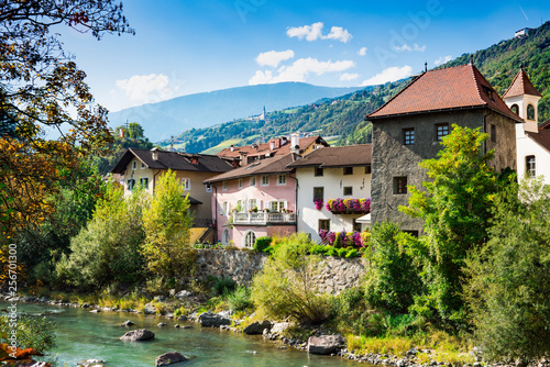 Foto auf Leinwand Cappuccino colorful houses along river Isarco (Eisack), Chiusa, Italy