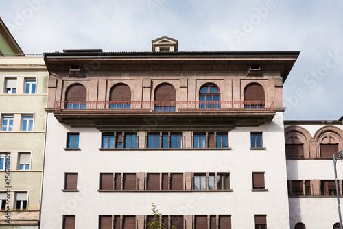 Fotografie, Obraz  white apartment with brown shutters,  Bolzano,  Italy
