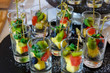 Dessert from small pieces of fruit in a glass cup