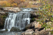 Water Flows Smooth And Gracefully Over The Rocks At The Falls In Joplin, MO On An Autumn Day.