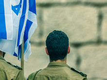 Israeli Soldiers With Flag Of Israel On Blurred Background Of Western Wall