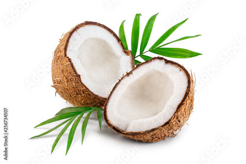 Photo  half of coconut with leaves isolated on white background