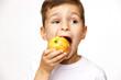 Little boy is eating apple studio shot