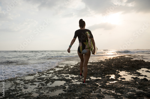 Woman surfer with surfboard going to surf Canvas Print