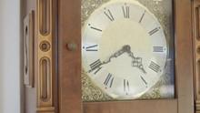 Closeup Tilting Shot Of An Old Grandfather Clock.