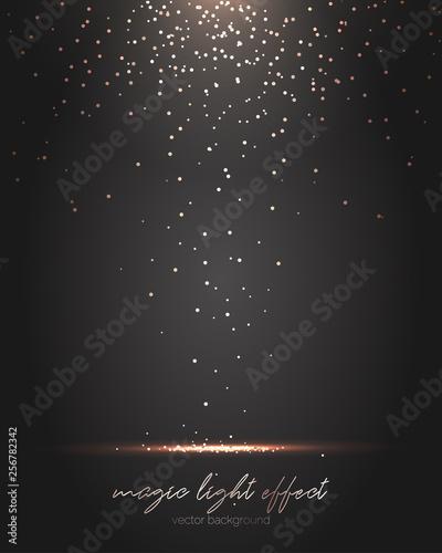 Fotografia Falling gold particles. Golden rain background.