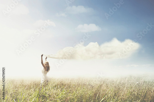 Fotografie, Obraz  sweet dream of a girl carrying a cloud in the sky