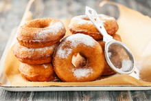 Homemade Donuts  With Powdered Sugar On A Wooden Baclground