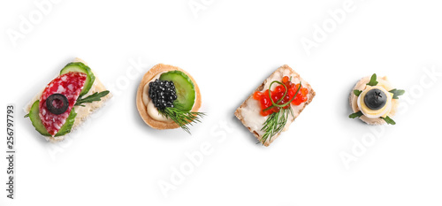 Papel de parede Assortment of tasty canapes on white background