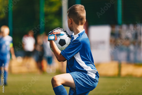Young Soccer Goalie Goalkeeper Catching Ball Young Boy Soccer Goalie Soccer Game On Sunny Summer Day Sport Activities For Children Football Match In The Background Youth Sport Wallpaper Buy This Stock