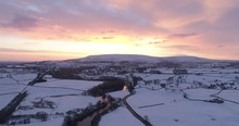 Aerial Shot Of Dramatic Sunrise In The Snow Covered Valley .