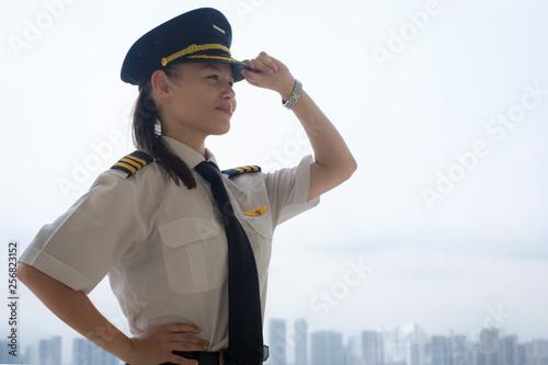 Valokuvatapetti Proud female pilot at the airport.