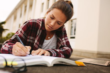 College Girl Studying At Campus