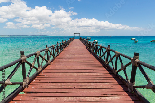 Printed kitchen splashbacks Zanzibar wooden bridge on sea