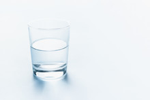 Half Full Glass Of Water. Abstract Background.