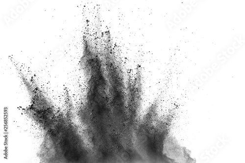 Fototapeta Black powder explosion against white background
