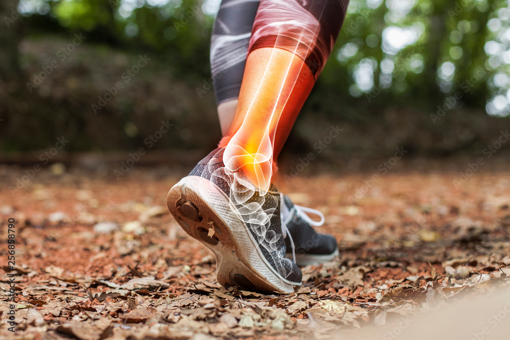 Fototapety, obrazy: Ankle pain in detail - Sports injuries concept.