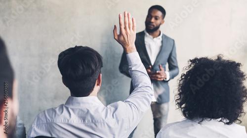 Businessman raising his hand, having question, crop