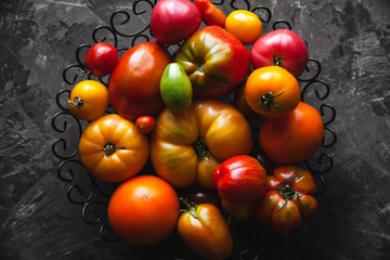 Tomatoes on a gray background, healthy food, vegetables