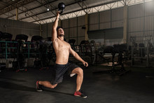 Athlete Doing Kettlebells Swing Exercise At Cross Fit Gym. Handsome Man Doing Functional Training Practicing Workout. Copy Space. - Image