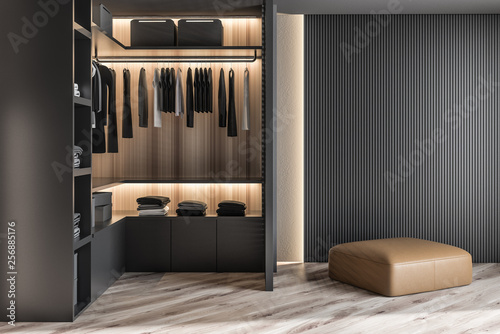 Modern wooden wardrobe with clothes hanging on rail in walk in closet design interior Fotobehang
