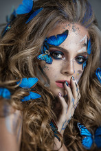 Girl With Butterflies In Her H...