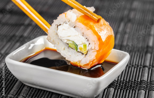sushi roll dipped in soy sauce Canvas Print