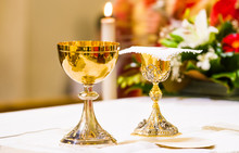 Cup With Wine And Ciborium With Host On The Altar Of The Holy Mass