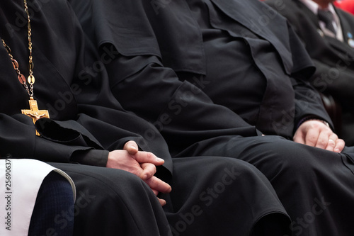 Photo Representatives of the Orthodox clergy in black robes sit in the conference hall