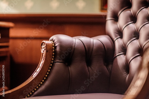 Photo sur Aluminium Retro Soft leather Armchair in a luxurious interior