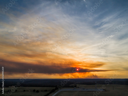 Aerial sunset with a large brush fire