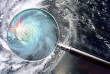 Hurricane And Magnifying Glass With Wind Speed Direction Scheme Range Of Speeds And Surface Winds In Zoomed Area. Studying The Weather Concept. Elements Of This Image Furnished By NASA.