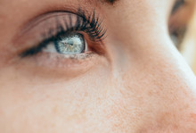 Make-up Beautiful Young Woman's Blue Eyes
