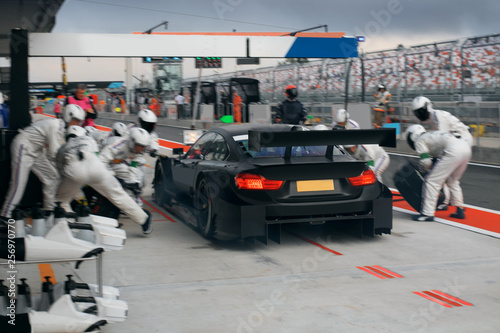 Foto Race car on the pit stop in motion