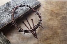 Jesus Crown Thorns And Nails On Old And Grunge Wood Background. Vintage Retro Style.