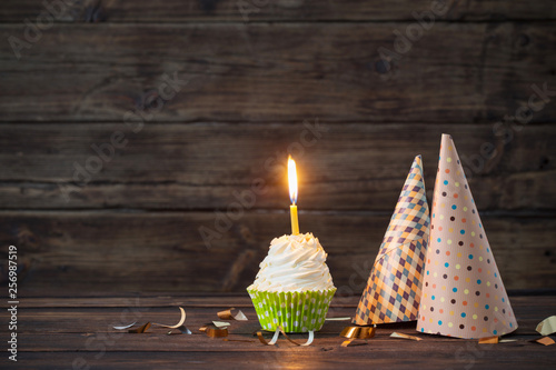 Cuadros en Lienzo birthday cupcakes with candles on old dark  wooden background