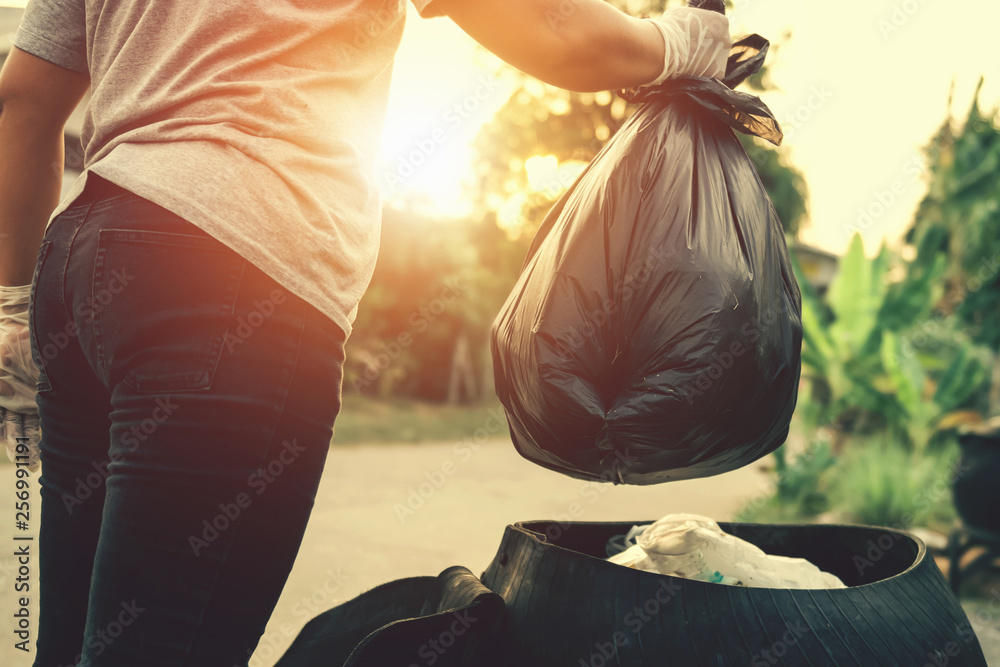 Fototapeta woman hand holding garbage bag for recycle cleaning