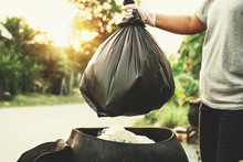 Woman Hand Holding Garbage Bag For Recycle Cleaning