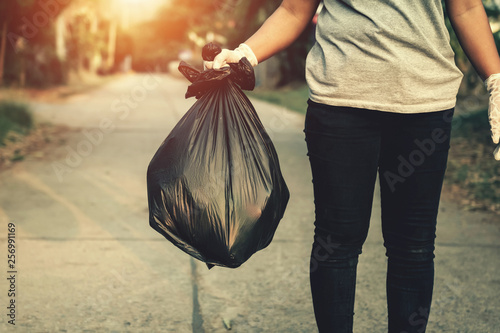 Photo woman hand holding garbage bag for recycle cleaning