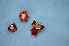 Set Of Vintage Red Badges With The Image Of Vladimir Lenin Of Soviet Union Era. Gray Background.