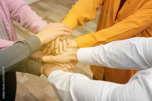 Fototapety, obrazy: Group of volunteers putting their hands together indoors, closeup