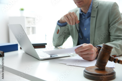 Fotografía  Notary working at table in office, closeup