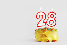 Twenty Eight Years Anniversary. Birthday Cupcake With White Burning Candles With Red Border In The Form Of Number Twenty Eight. Light Gray Background With Copy Space