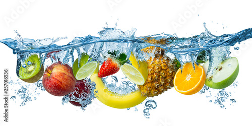 Poster Cuisine fresh multi fruits splashing into blue clear water splash healthy food diet freshness concept isolated white background