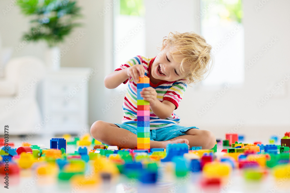 Fototapety, obrazy: Child playing with toy blocks. Toys for kids.